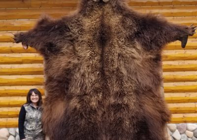 New SCI AK Member Kim Williams with her trophy brown bear