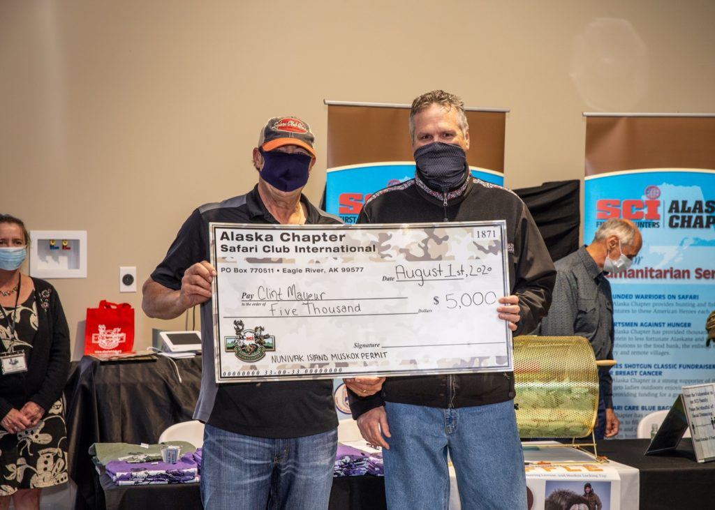 SCI Alaska Chapter and Alaska Governor Mike Dunleavey present the $5,000 check for Alaska Governor's Nunivak Island Muskox Raffle winner Clint Mayeur.